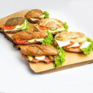 Bagels with fillings - Chia bagel with grilled vegetables, parmesan and rocket